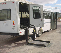 A Creighton shuttle bus equipped with a wheelchair lift.