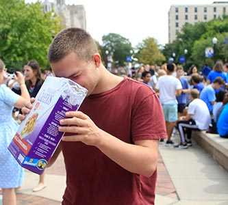 Moon over the Mall: Creighton stops to take in solar eclipse