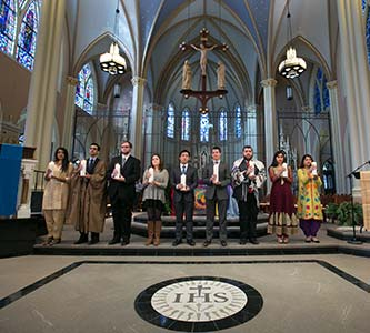 Student participation at world gathering of religions informs Interfaith Prayer Service