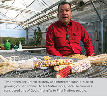 person in greenhouse with corn